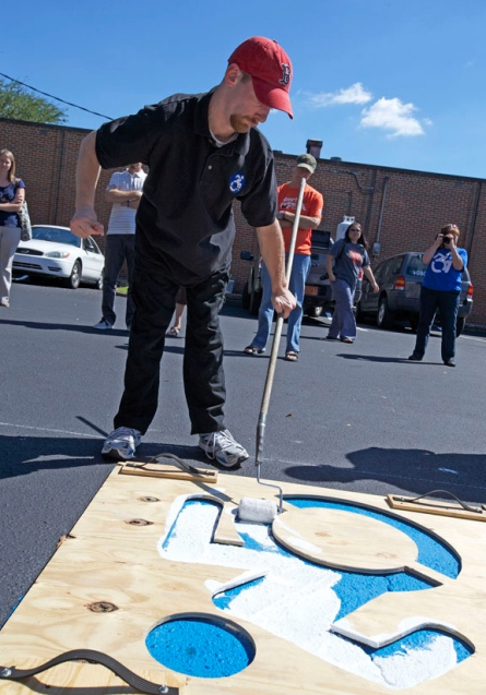 Events often look like this one, where self-advocates with disabilities are able to speak for themselves to able-bodied counterparts, advocating for the features of an inclusive world that are important to them. The physical act of painting over faded parking lot stencils makes the project an event-based one, not just a graphic.