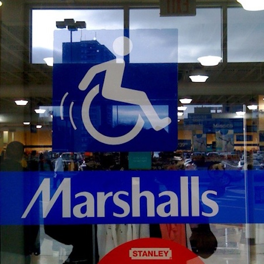 The sliding doors at Marshalls have a wheelchair-riding icon that shows the figure moving through space, with motion lines to show its movement.